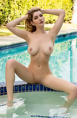 Goddess Skye Blue Posing Naked By The Pool