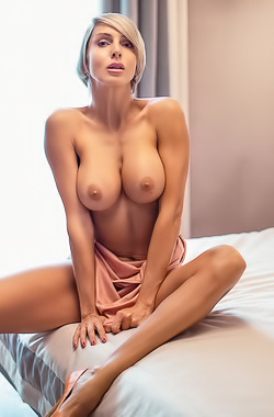 Glamour Blond Tanita Showing Round Boobs