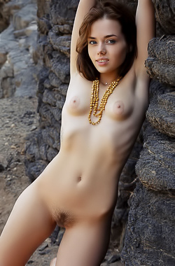Keira Blue - Skinny brunette takes off her dress and poses nude on rock