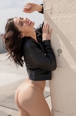 Divina strips it down and has some naked fun on the roof
