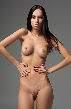 Skinny brunette poses on camera