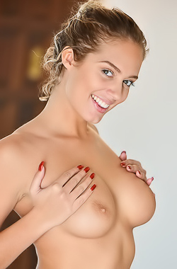 Athena FTV Busty Athena FTV lifts up skirt to show juicy pussy