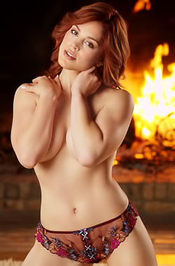 Molly Stewart is blazing hot in front of the fire